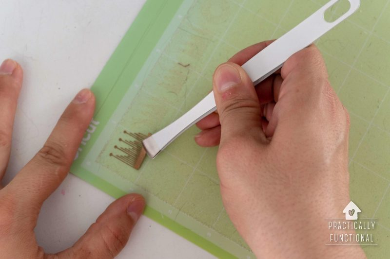 Use broad tipped tweezers to gently remove delicate pieces of paper flowers from cricut mat