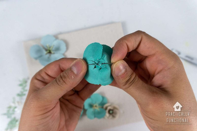 Use straight pins to attach diy paper flowers to shadow box backing board
