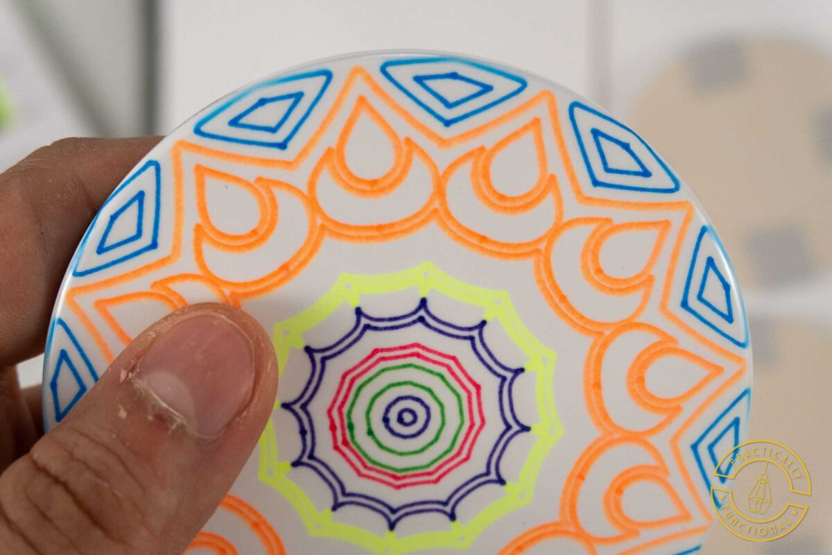 Close up of cricut infusible ink pens and markers on a ceramic coaster