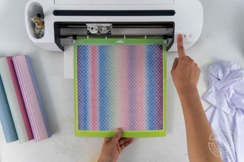 Load cricut infusible ink transfer sheets onto the cutting mat ink side up