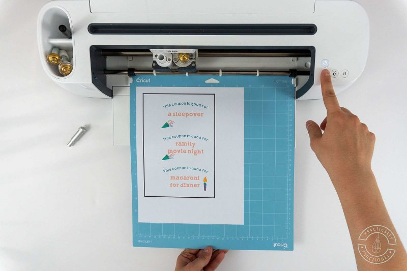 Load your printed birthday coupons into your cricut maker for cutting and perforating