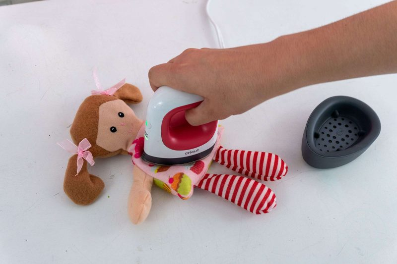 Use the cricut easypress mini to press small or odd shaped areas like stuffed animals or dolls