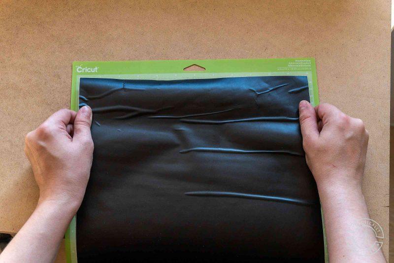 Apply adhesive vinyl to cricut cutting mat