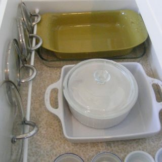 How to organize kitchen drawers with a tension rod