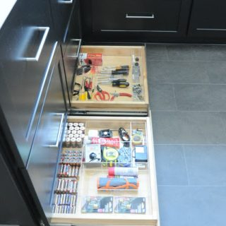 How to organize toekick drawers under black kitchen cabinets