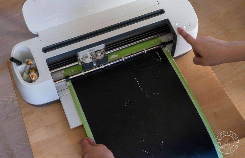 Unload cricut cutting mat and cut design from cricut maker