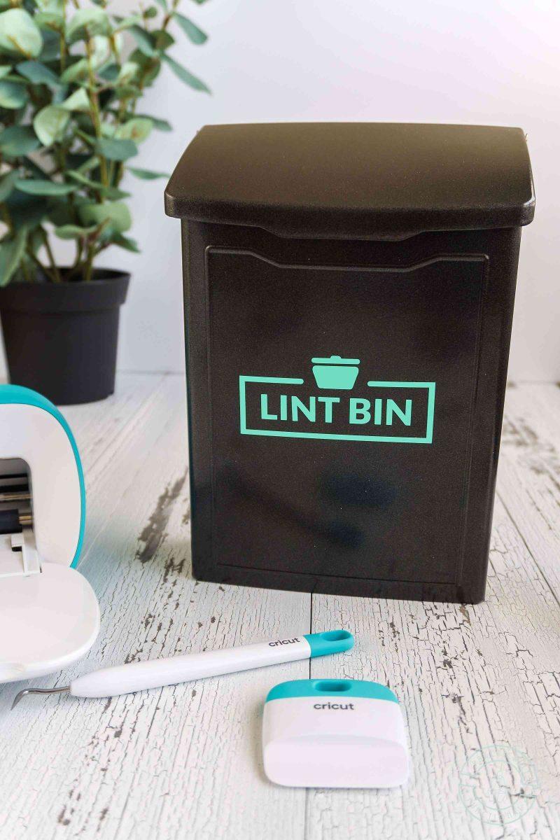 Laundry room lint bin made with cricut joy