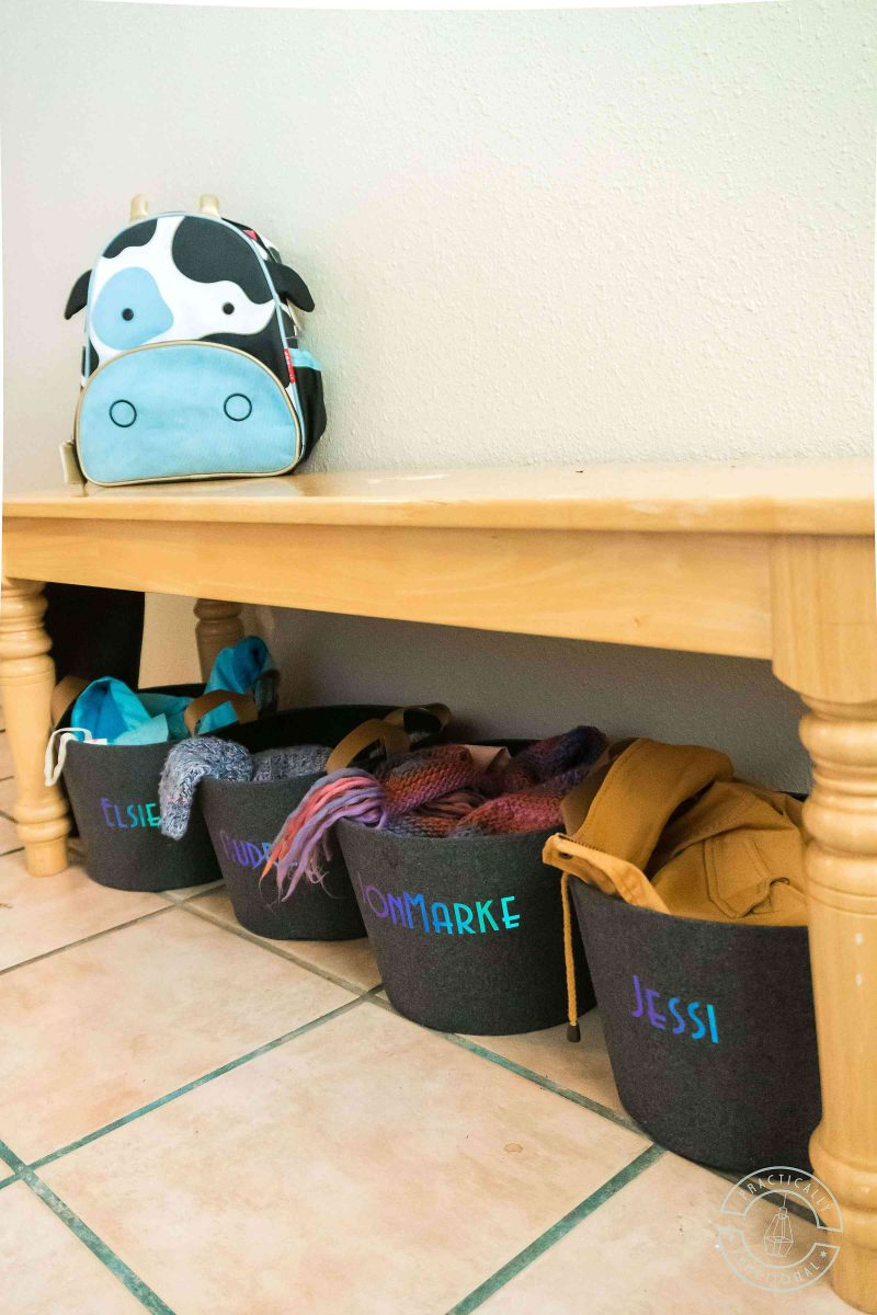 Make your own personalized storage bins to organize your entryway with a cricut joy and smart holographic vinyl