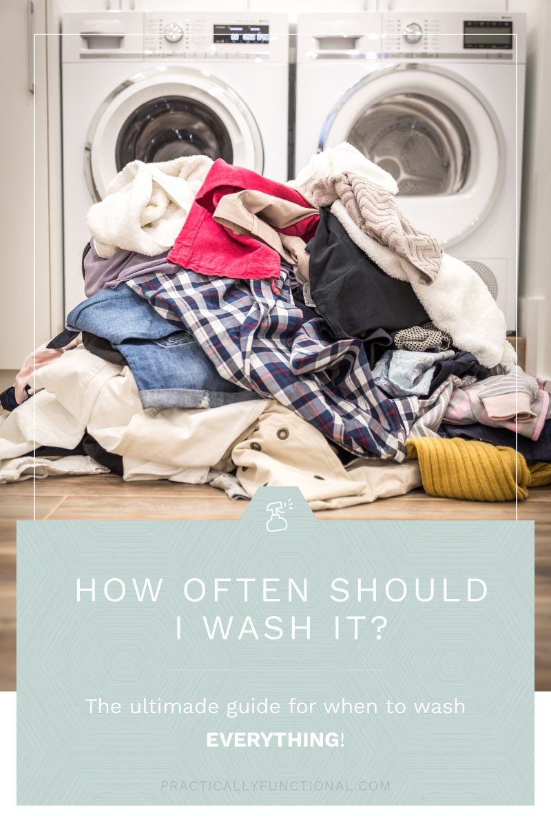 """large pile of clothes on wooden floor in front of white washing machine and white dryer with text """"How often should I wash it? The ultimate guide for when to wash everything!"""""""