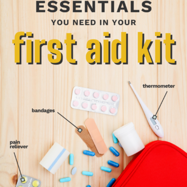red first aid kit open with emergency essentials and supplies spilling out